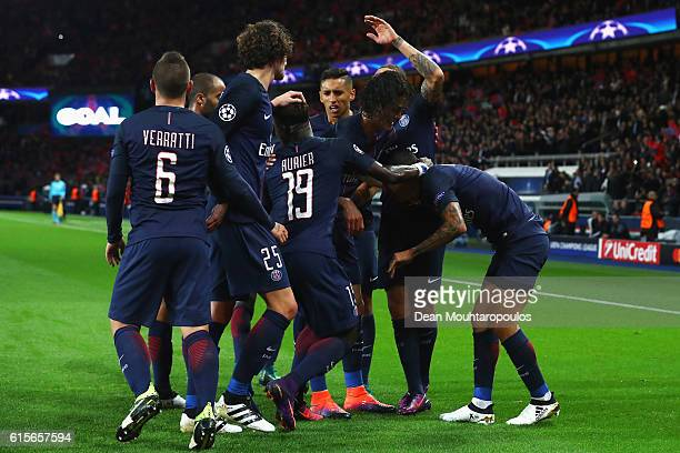 Angel Di Maria of PSG celebrates scoring his teams first goal of the game with team mates during the Group A UEFA Champions League match between...