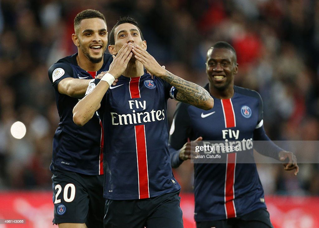 Angel Di Maria of PSG celebrates scoring the first goal with Layvin Kurzawa and Blaise Matuidi of PSG during the French Ligue 1 match between Paris Saint-Germain (PSG) and Toulouse FC (TFC) at Parc des Princes stadium on November 7, 2015 in Paris, France.