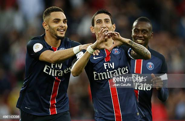 Angel Di Maria of PSG celebrates scoring the first goal with Layvin Kurzawa and Blaise Matuidi of PSG during the French Ligue 1 match between Paris...
