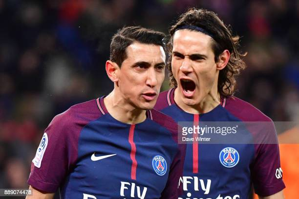 Angel Di Maria of PSG celebrates with Edinson Cavani of PSG after putting their side 10 ahead during the Ligue 1 match between Paris Saint Germain...