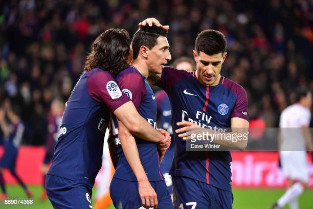 Angel Di Maria of PSG celebrates with Edinson Cavani of PSG and Yuri Berchiche of PSG after putting their side 10 ahead during the Ligue 1 match...