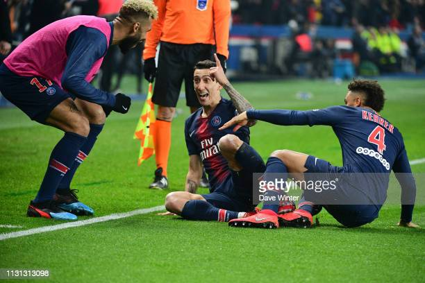 Angel Di Maria of PSG celebrates with Eric Maxim Choupo Moting of PSG and Thilo Kehrer of PSG after putting their side 31 ahead during the Ligue 1...