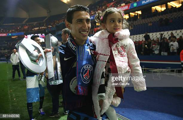 Angel Di Maria of PSG celebrates with his daughter Mia Di Maria winning the French Ligue 1 championship following the French Ligue 1 match between...