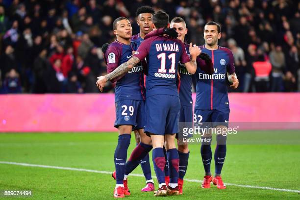Angel Di Maria of PSG celebrates with teammates after putting his side 10 ahead during the Ligue 1 match between Paris Saint Germain and Lille OSC at...