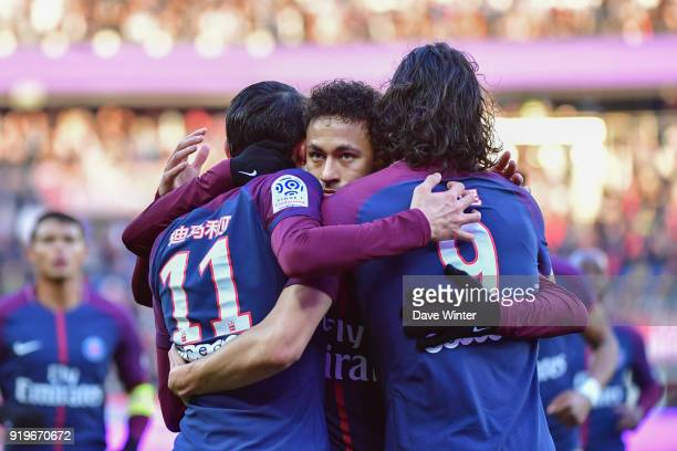 Angel Di Maria of PSG is congratulated by Neymar JR of PSG and Edinson Cavani of PSG after putting their side 31 ahead during the Ligue 1 match...