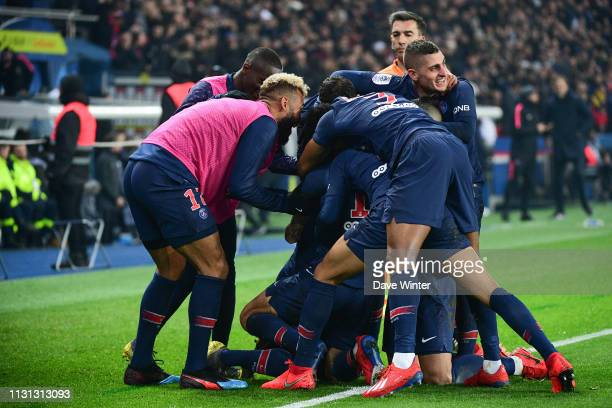 Angel Di Maria of PSG is mobbed after putting their side 31 ahead during the Ligue 1 match between Paris Saint Germain and Marseille at Parc des...