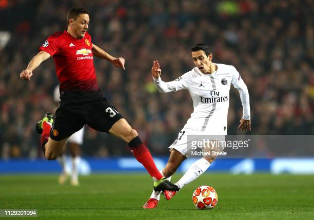 Angel Di Maria of PSG is tackled by Nemanja Matic of Manchester United during the UEFA Champions League Round of 16 First Leg match between...