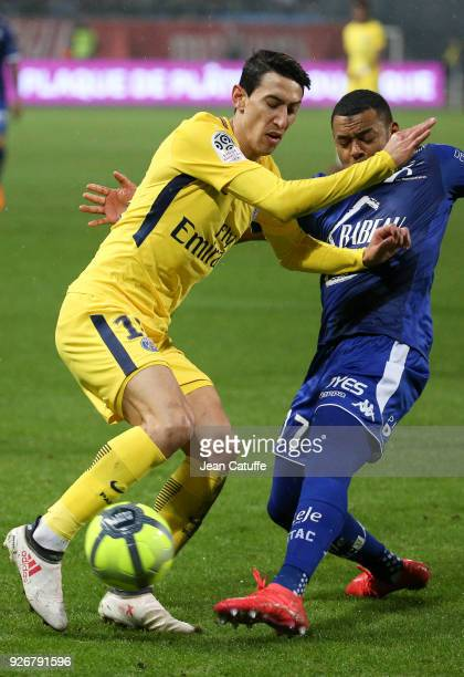 Angel Di Maria of PSG Johann Obiang of Troyes during the Ligue 1 match between ESTAC Troyes and Paris Saint Germain at Stade de l'Aube on March 3...