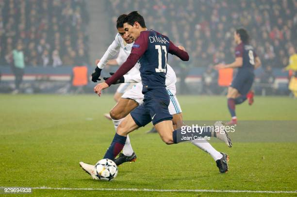 Angel Di Maria of PSG Raphael Varane of Real Madrid during the UEFA Champions League Round of 16 Second Leg match between Paris SaintGermain and Real...