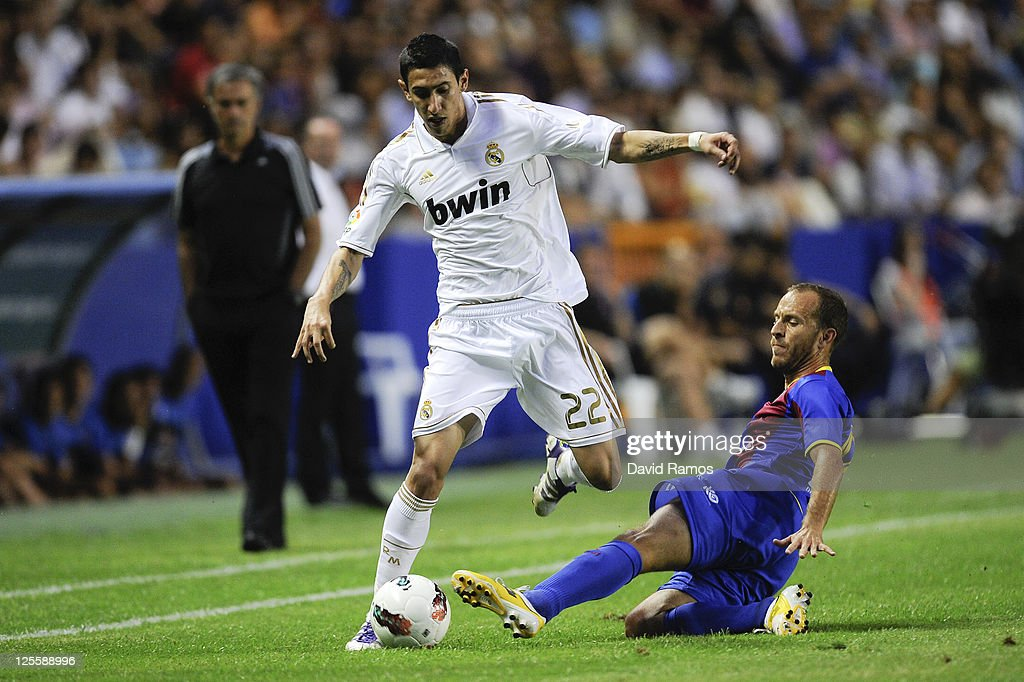 Angel Di Maria (L) of Real Madrid battles for the ball with Juan Luis Gomez of Levante UD during the La Liga match between Levante UD and Real Madrid CF at Ciutat de Valencia Stadium on September 18, 2011 in Valencia, Spain.