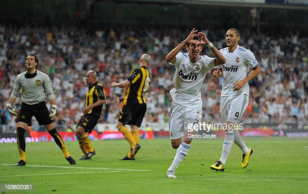 Angel Di Maria of Real Madrid celebrates beside Karim Benzema after scoring Real's first during the Santiago Bernabeu Trophy match between Real...