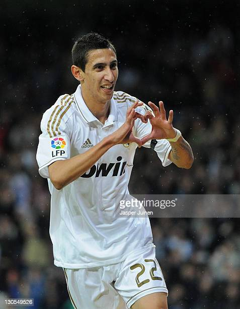 Angel Di Maria of Real Madrid celebrates scoring his sides third goal during the la Liga match between Real Madrid and Villarreal at the Estadio...