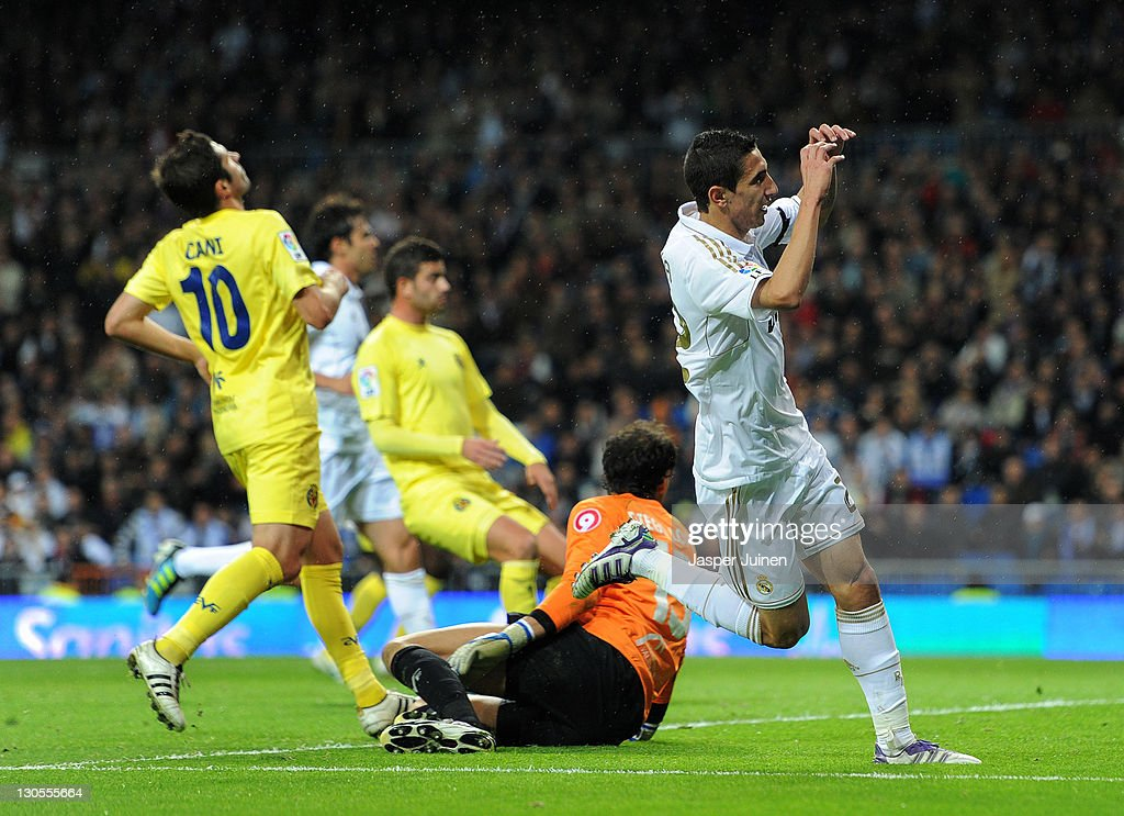 Angel Di Maria (R) of Real Madrid celebrates scoring his sides third goal during the la Liga match between Real Madrid and Villarreal at the Estadio Santiago Bernabeu on October 26, 2011 in Madrid, Spain.