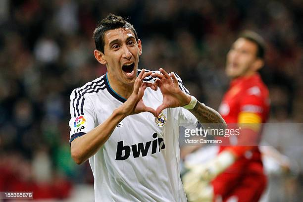 Angel Di Maria of Real Madrid celebrates scoring his team's second goal during the La Liga match between Real Madrid and Real Zaragoza at Bernabeu...