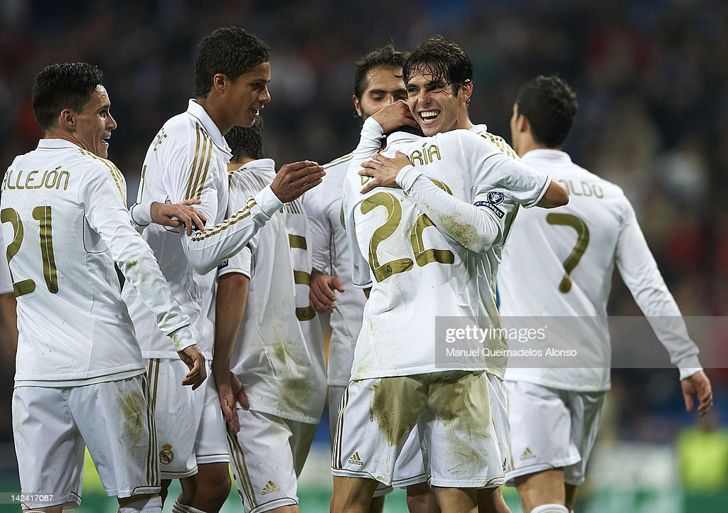 Angel Di Maria of Real Madrid celebrates scoring with his teammate Kaka during the UEFA Champions League quarter-final second leg match between Real Madrid and APOEL FC at Bernabeu on April 4, 2012 in Madrid, Spain.