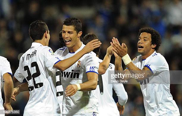 Angel di Maria of Real Madrid celebrates with Cristiano Ronaldo and Marcelo after scoring Real's first goal during the La Liga match between Hercules...