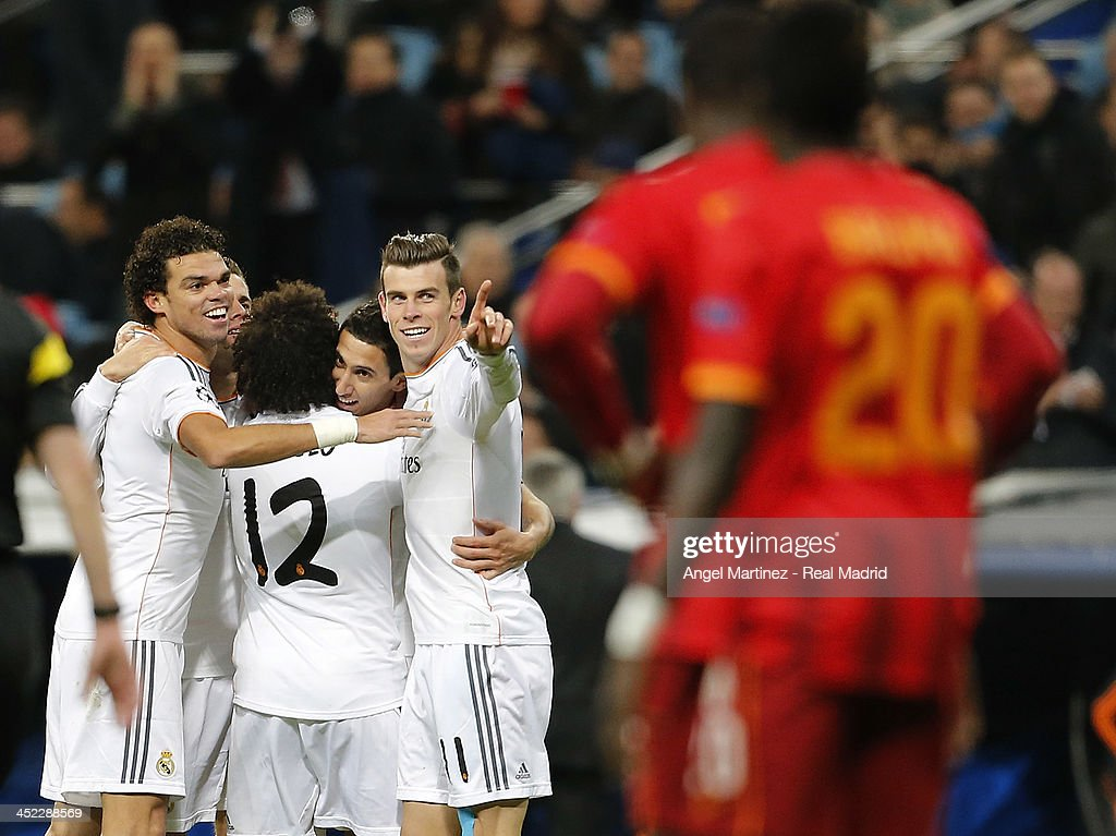 Angel di Maria (2nd R) of Real Madrid celebrates with Gareth Bale after scoring their team's third goal during the UEFA Champions League Group B match between Real Madrid and Galatasaray AS at Estadio Santiago Bernabeu on November 27, 2013 in Madrid, Spain.
