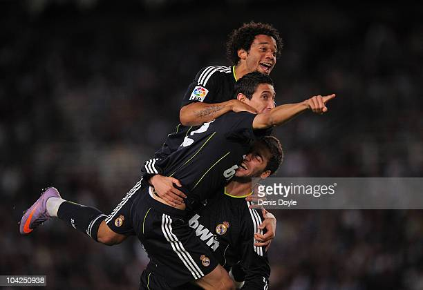 Angel Di Maria of Real Madrid celebrates with Gonzalo Higuain and Marcelo after scoring Real's first goal during the La Liga match between Real...