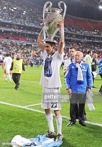 Angel Di Maria of Real Madrid celebrates with the trophy following his team's 41 victory during to the UEFA Champions League Final between Real...