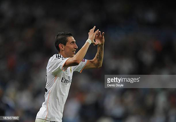Angel Di Maria of Real Madrid CF celebrates after scoring Real's 4th goal during the UEFA Champions League match between Real Madrid CF and FC...