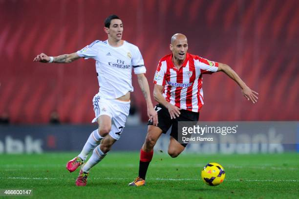 Angel Di Maria of Real Madrid CF duels for the ball with Mikel Rico of Athletic Club during the La Liga match between Athletic Club and real Madrid...