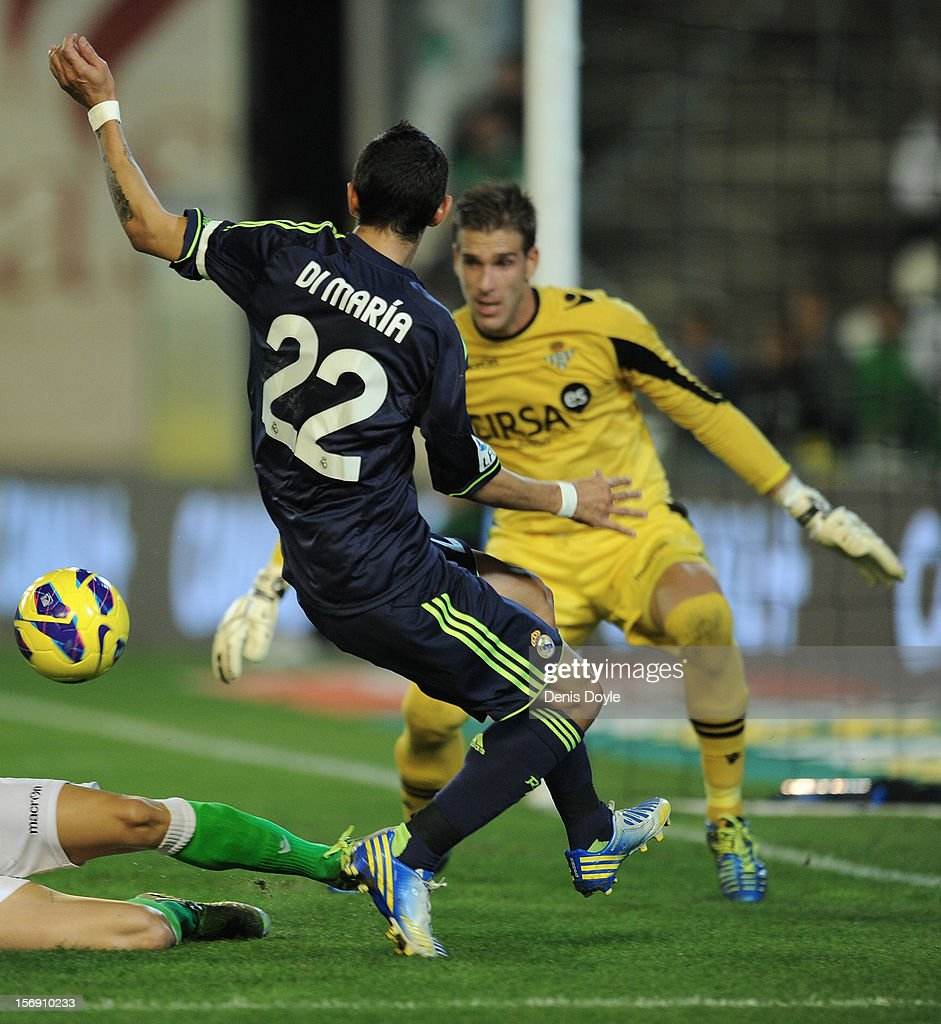 Angel Di Maria (R) of Real Madrid CF gets his shot at goal blocked by Adrian San Miguel of Real Betis Balompie during the La Liga match between Real Betis Balompie and Real Madrid CF at Estadio Benito Villamarin on November 24, 2012 in Seville, Spain.