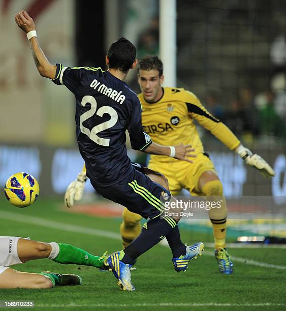 Angel Di Maria of Real Madrid CF gets his shot at goal blocked by Adrian San Miguel of Real Betis Balompie during the La Liga match between Real...