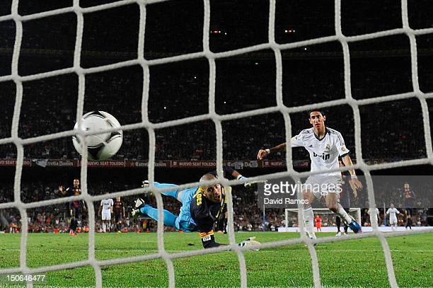 Angel Di Maria of Real Madrid CF scores his team's second goal during the Super Cup first leg match between FC Barcelona and Real Madrid at Camp Nou...