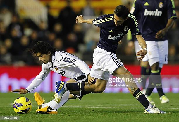 Angel di Maria of Real Madrid competes for the ball with Ever Banega of Valencia during the La Liga match between Valencia CF and Real Madrid at...