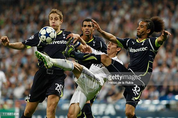 Angel di Maria of Real Madrid duels for the ball with Michael Dawson and Benoit AssouEkotto of Tottenham during the UEFA Champions League quarter...