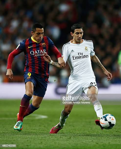 Angel Di Maria of Real Madrid is challenged by Alexis Sanchez of Barcelona during the La Liga match between Real Madrid CF and FC Barcelona at the...