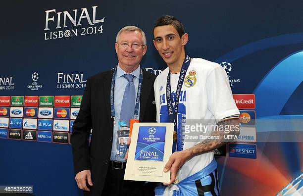 Angel Di Maria of Real Madrid is presented with the Man of the Match award by Former Manchester United Manager Sir Alex Ferguson following with the...
