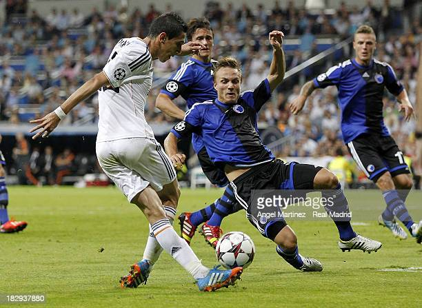 Angel di Maria of Real Madrid passes the ball past Pierre Bengtsson of FC Copenhagen during the UEFA Champions League group B match between Real...
