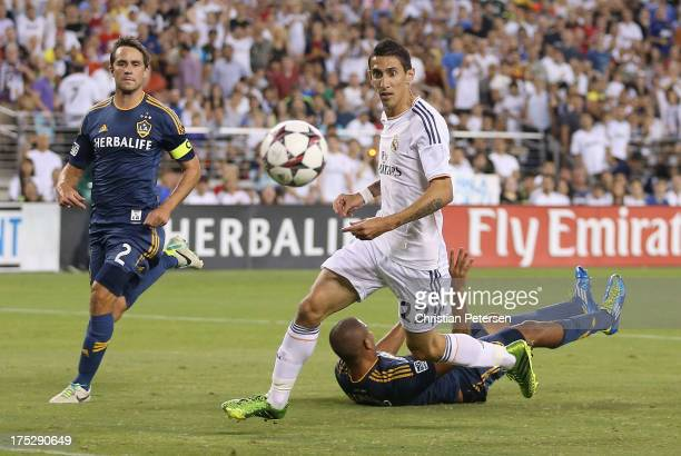 Angel Di Maria of Real Madrid scores a first half goal past Todd Dunivant and Leonardo of the Los Angeles Galaxy during the International Champions...