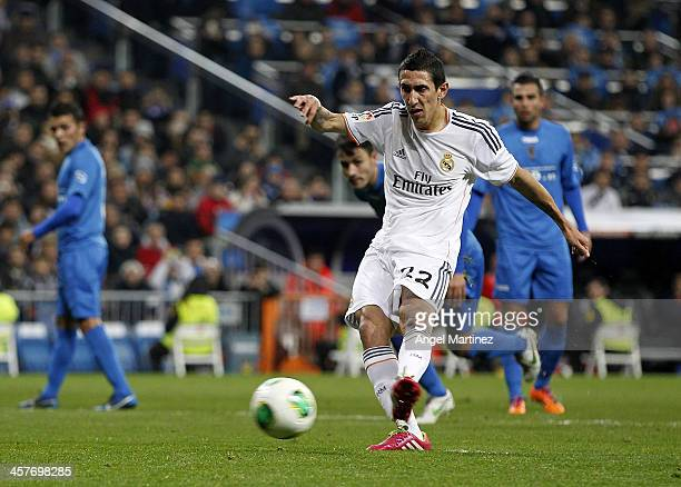 Angel di Maria of Real Madrid scores from penalty spot his team's second goal during the Copa del Rey round of 32 match between Real Madrid and...