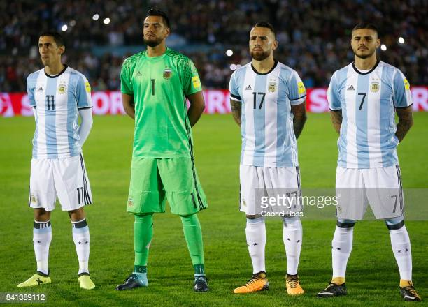 Angel Di Maria Sergio Romero Nicolas Otamendi and Mauro Icardi of Argentina line up for the National Anthem prior to a match between Uruguay and...