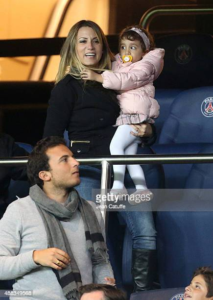 Angel Di Maria's wife and daughter Jorgelina Cardoso and Mia Di Maria celebrate his goal during the UEFA Champions League match between Paris...