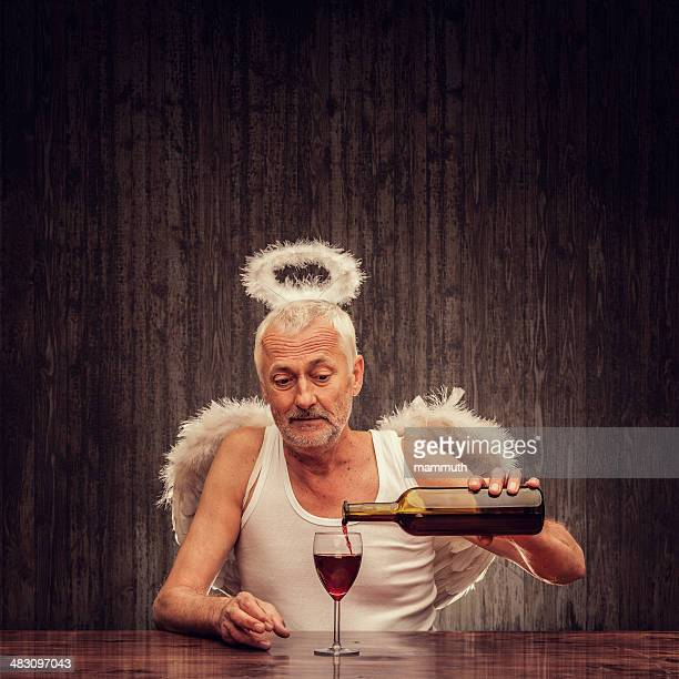angel drinking in a pub - male angel stock photos and pictures