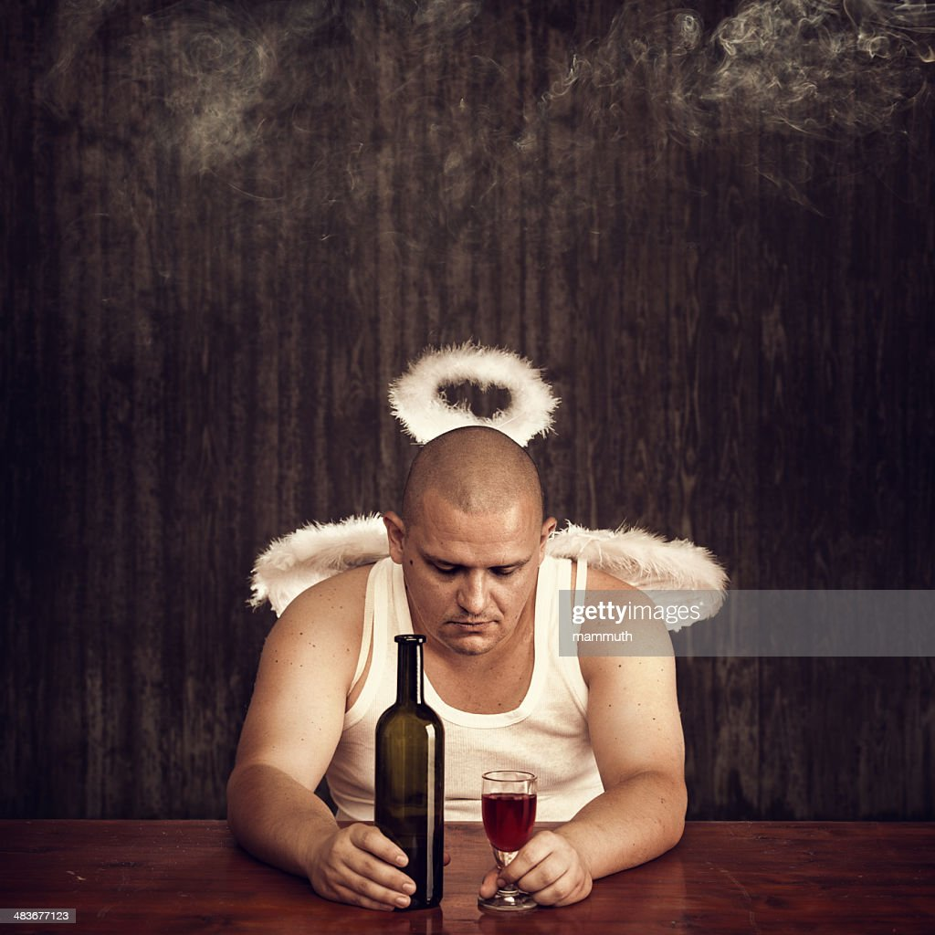 angel drinking in a pub : Stock Photo