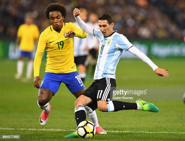 Angel Fabian Dimaria of Argentina shoots for goal infront of Willian Silva of Brazil during the Brazil Global Tour match between Brazil and Argentina...