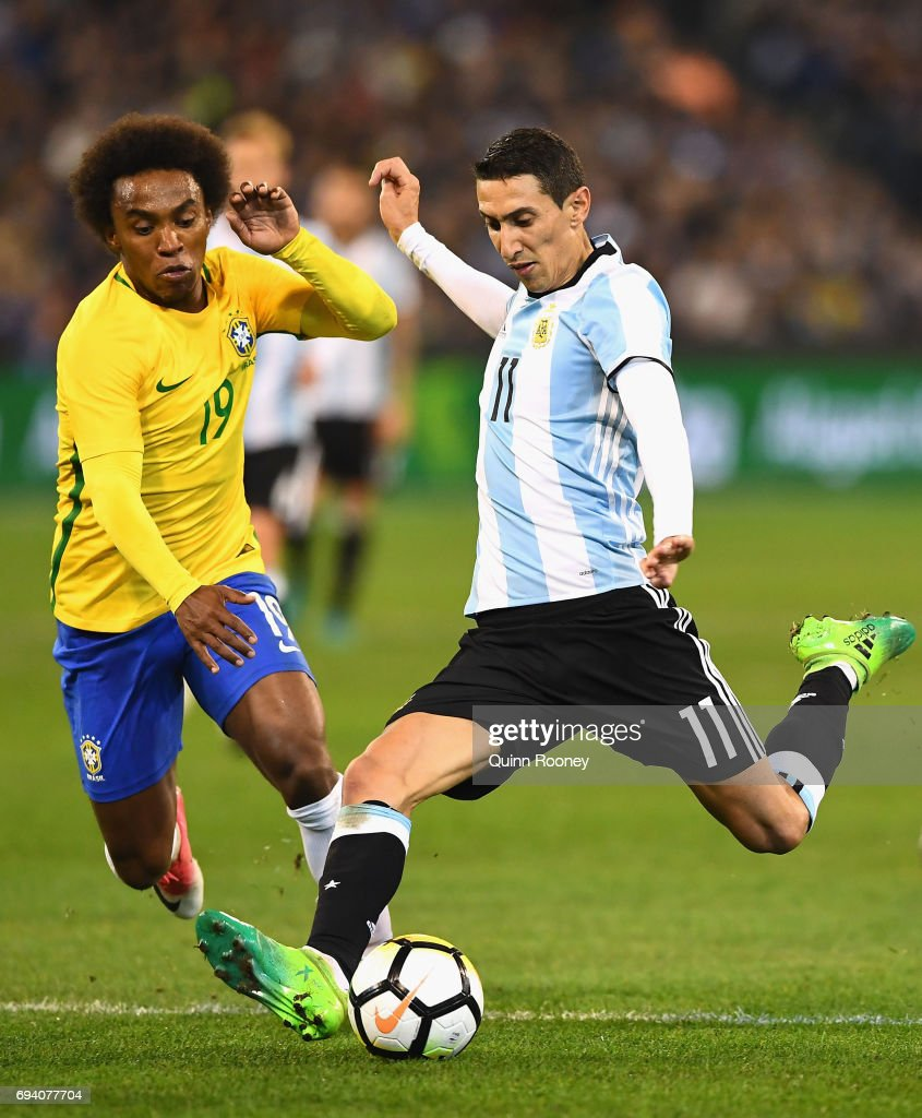 Angel Fabian Dimaria of Argentina shoots for goal infront of Willian Silva of Brazil during the Brazil Global Tour match between Brazil and Argentina at Melbourne Cricket Ground on June 9, 2017 in Melbourne, Australia.