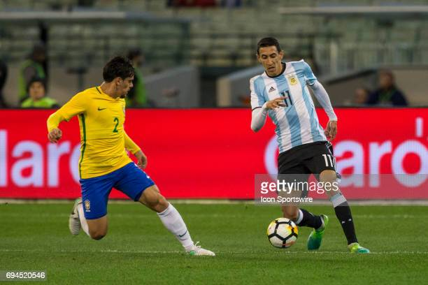 Angel Fabian Dimaria of the Argentinan National Football Team controls the ball in front of Fagner Lemos of the Brazilian National Football Team...