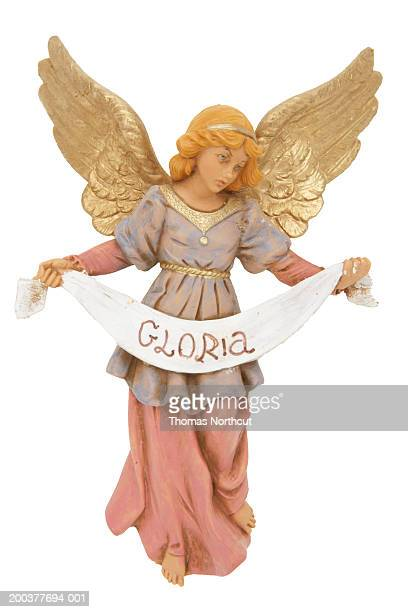 Angel figurine with 'Gloria' banner