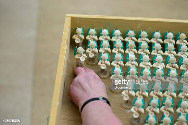 Angel figurines sit to dry after being glued together during traditional Christmas tree ornament manufacture at Wendt Kuehn KG in Gruenhainichen...