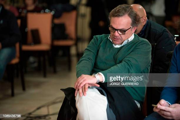Angel Garcia delegate of Malaga's civil engineers gestures as he attends a press conference a press conference in Cala del Moral near Malaga on...
