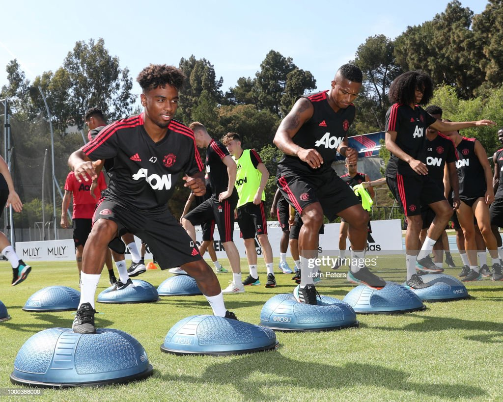 Angel Gomes (L) and Antonio Valencia of Manchester United in action during a Manchester United pre-season training session at UCLA on July 16, 2018 in Los Angeles, California.