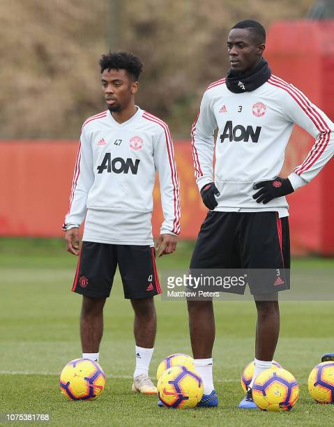 Angel Gomes and Eric Bailly of Manchester United in action during a first team training session at Aon Training Complex on December 28 2018 in...