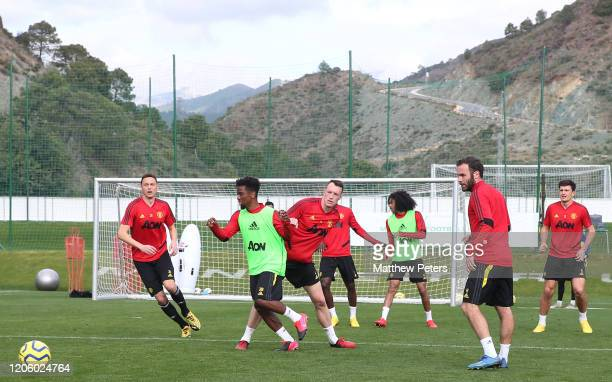 Angel Gomes and Phil Jones of Manchester United in action during a first team training session on February 13, 2020 in Malaga, Spain.