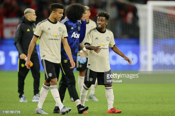 Angel Gomes and Tahith Chong of Manchester United acknowledge fans after the match between the Perth Glory and Manchester United at Optus Stadium on...