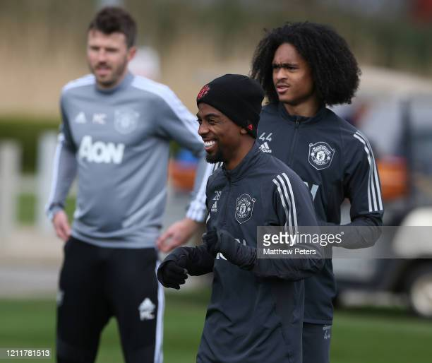 Angel Gomes and Tahith Chong of Manchester United in action during a first team training session at Aon Training Complex on March 11, 2020 in...